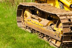 Muddy caterpillar tracks on bulldozer. - stock photo