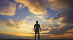 The man stand on the background of cloud flow. Time lapse Stock Footage