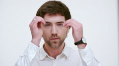 Man fixing his hair. Close up. Slow motion Stock Footage