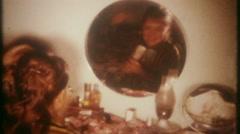 3322 teenage girls apply makeup & fix their hair - vintage film home movie Stock Footage