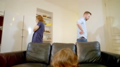 Little boy trying to ignore as parents fight at home Stock Footage