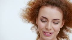 Beautiful redhead girl laughing. Close up. Slow motion Stock Footage