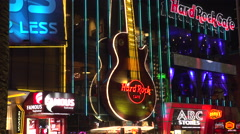 4K: Neon Guitar Plays at Hard Rock Cafe - Las Vega Strip Stock Footage