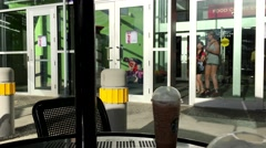 One side of mall entrance beside Starbucks coffee store Stock Footage