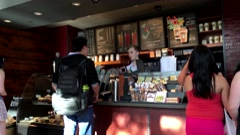Customer buying coffee at Starbucks - stock footage