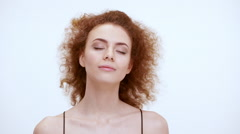 Beautiful dreamy redhead girl going to the wind. Close up. Slow motion Stock Footage