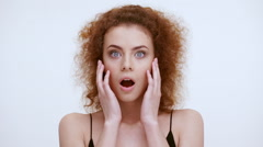 Beautiful redhead girl shocked and scared. Close up. Slow motion Stock Footage