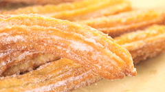 Close up view of Bunch of churros covered with granulated sugar. Stock Footage