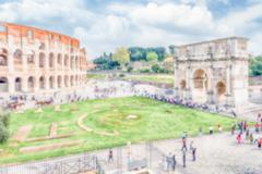 Defocused background with the Colosseum and Arch of Constantine, Rome - stock photo