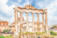 Defocused background with ruins of Saturn Temple in Rome, Italy - stock photo
