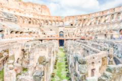 Defocused background with Interior of Flavian Amphitheatre, aka Colosseum, Ro Stock Photos