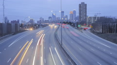 Minneapolis Riverside Skyline and Highway Traffic at Sunset Timelapse 4K - stock footage