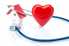 Family Care concept, house model and heart shape with stethoscope - stock illustration