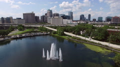 Wide fixed aerial of downtown Orlando with fountain Stock Footage