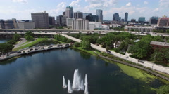 Flyover near downtown Orlando with fountain Stock Footage