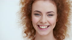 Beautiful redhead girl laughing. Close up Stock Footage