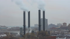 Generic Smoke and Steam Stacks in a Bustling Metropolis 4K Timelapse - stock footage