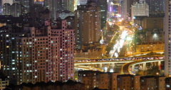 4k timelapse busy urban traffic on overpass at night,urban morden building,Qing Stock Footage