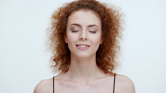 Beautiful smiling redhead girl dreaming. Close up Stock Footage