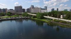 Close backwards flyover over fountain near downtown Orlando Stock Footage