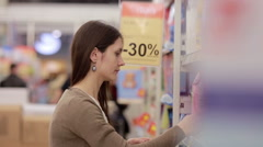 Woman chooses household chemicals in the store Stock Footage