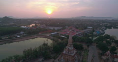 Sunsrise Over Buddhist Temple Pullback Aerial Reveal Shot Stock Footage