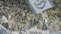 Football fans with a naked torso during a match . Slow motion Stock Footage
