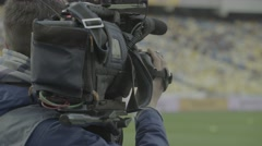 The cameraman shoots the game in the stadium (close-up) Stock Footage