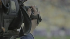 Close-up TV cameras in the stadium during live broadcast Stock Footage