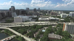 Wide fixed aerial of downtown Orlando with roads Stock Footage