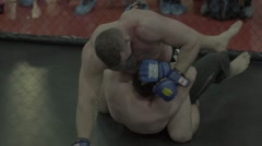 Male fighter beats the other during the fight . Octagon. MMA. Slow motion Stock Footage