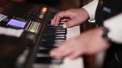 Hands of a man playing on a synthesizer Stock Footage