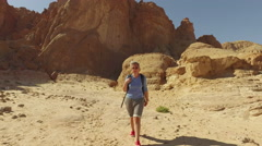 The heat and thirst in the red desert . People exploring new places . Stock Footage