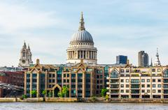 St Paul Cathedral and Millennium Bridge, London, UK. - stock photo