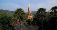 Buddhist Temple and Wat with Trees and Mountains Ascending Spherical Shot Stock Footage