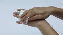 Wet paper wipe out from hands Stock Footage