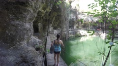 Swimming in a beautiful cenote in Tulum Mexico Stock Footage