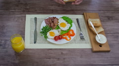 Breakfast with fried eggs and bacon. Stock Footage