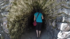 Woman in ancient Mayan tunnel at Coba Stock Footage