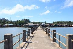 old wooden and concrete bridge to dock pier tranquil sea destination,Trang Th - stock photo