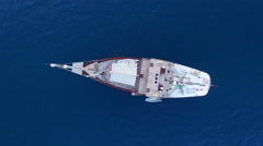 Aerial Video. Vertcal rotation video of a sailboat in the sea. N. Stock Footage
