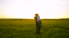 Man and woman in the sunset and swirling kiss - stock footage