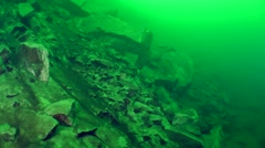 Underwater avalanche on a rocky slope. Stock Footage