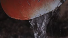 Rain water flowing from downpipe. closeup and pan Stock Footage
