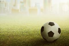 Football or soccer ball on the stadium Kuvituskuvat