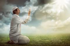 Young muslim man praying Stock Photos