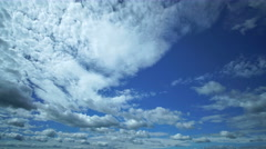 The flow of cloud against the blue sky. Time lapse Stock Footage