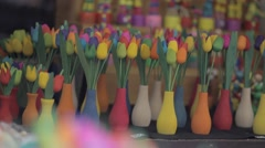 Colorful tulips in a wooden on a flower show Stock Footage