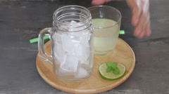 Glass of iced honey and lemon drink - stock footage