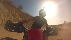 The guy rides a Quad bike in Thailand on the sand in the career - stock footage